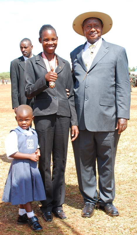 Inzikuru and her daughter pose with President Museveni after receing her medal-Photo Samson Baranga