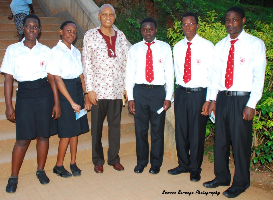 Students from King's College Buddo  grab a photo opportunity with Makerere's Chancellor Prof. Mondo Kagonyera