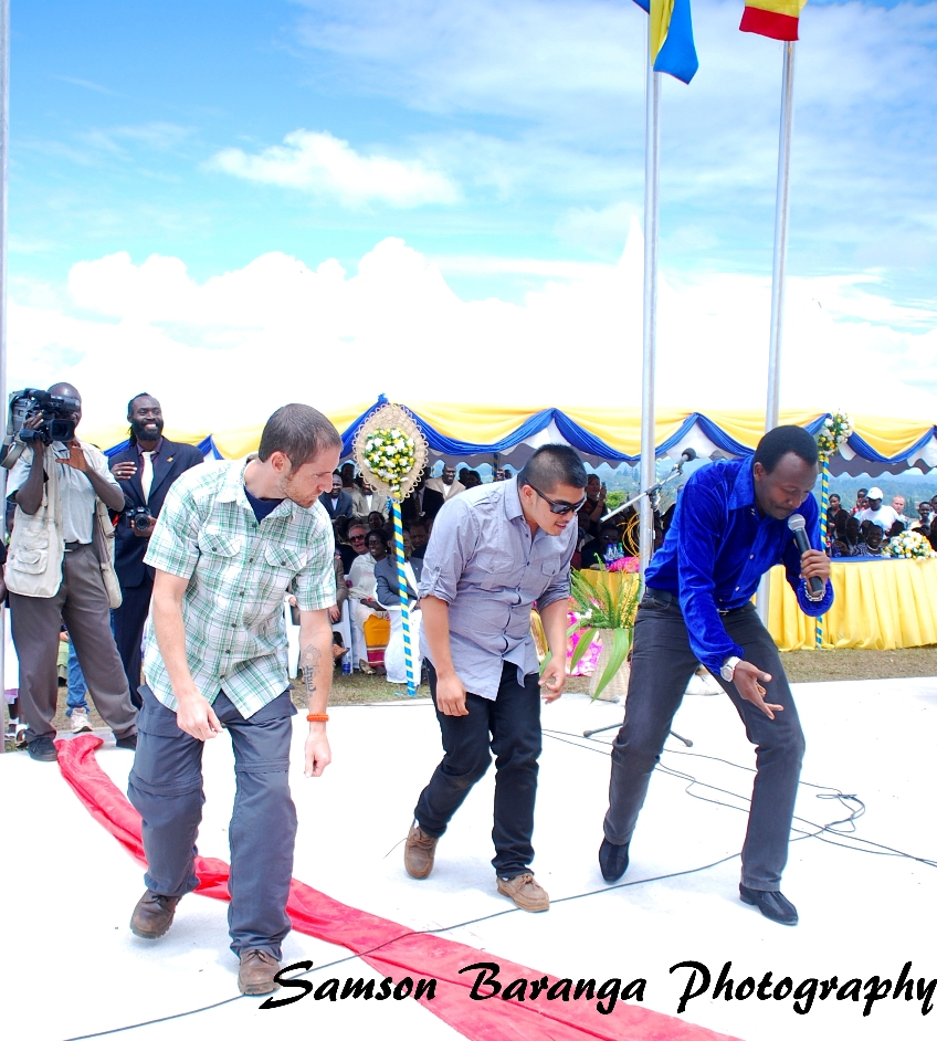 Local 'country musician' Rockamille (in blue)  performs at the ceremony. He has a Rutooro song praising the King.