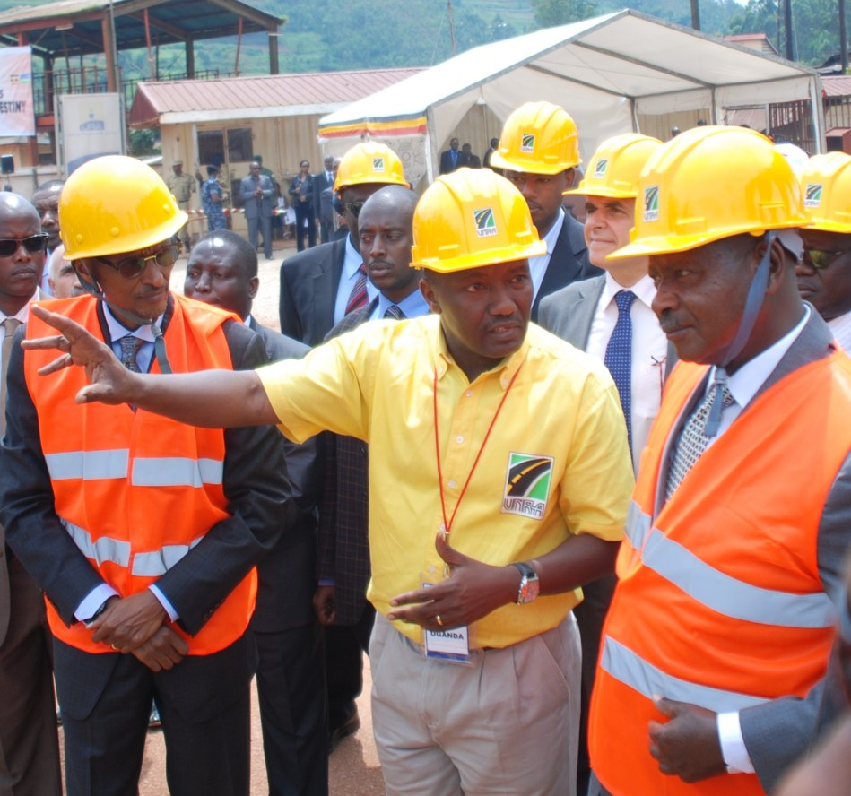 UNRA Publicist Dan Alinange (C) president Kagame and Museveni at the ground breaking ceremony