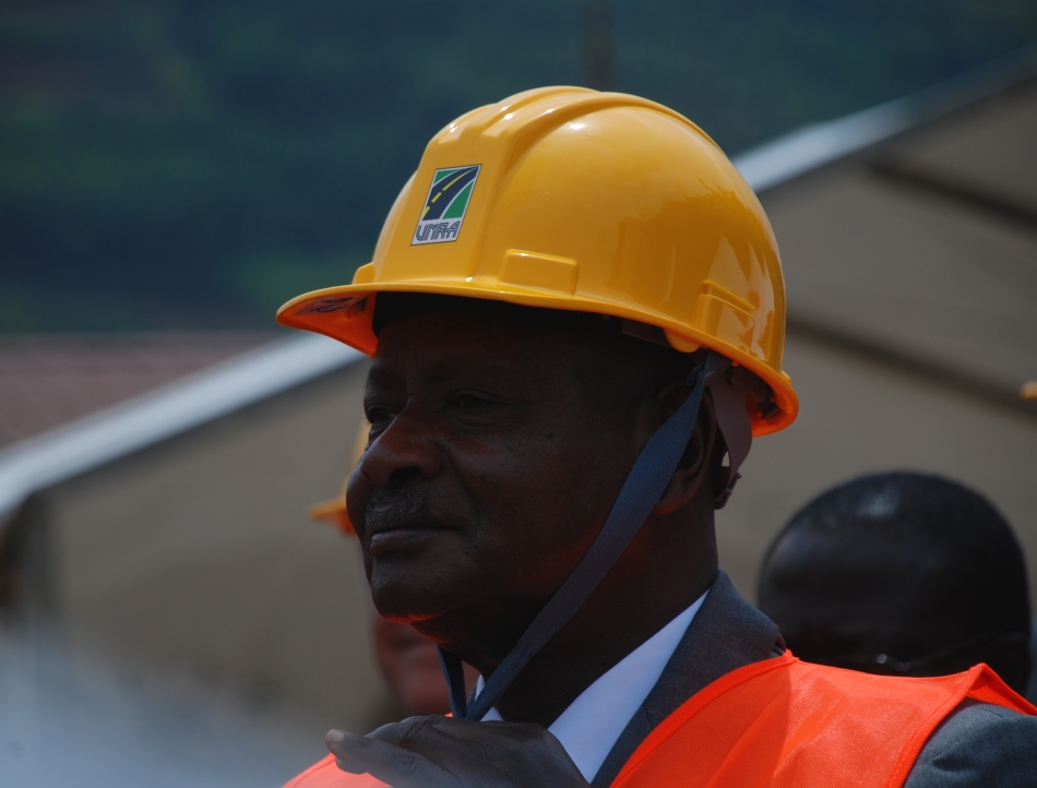 President Museveni puts on his helmet ready to enter the tractor