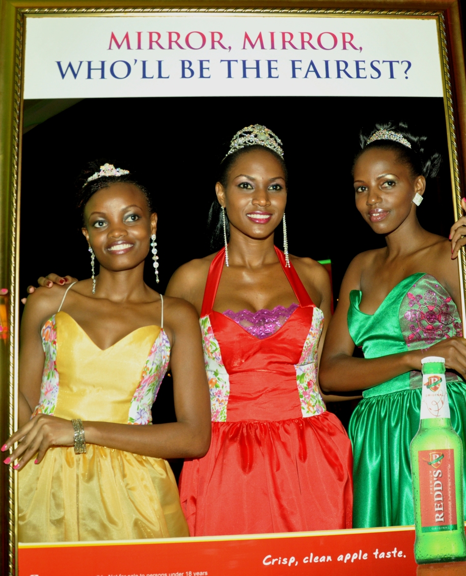 Reigning Miss Uganda Sylvia Namutebi (C) with the first and 2nd runner up