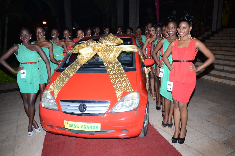 The finalists pose next to the grand prize A-Class Mercedese Benz