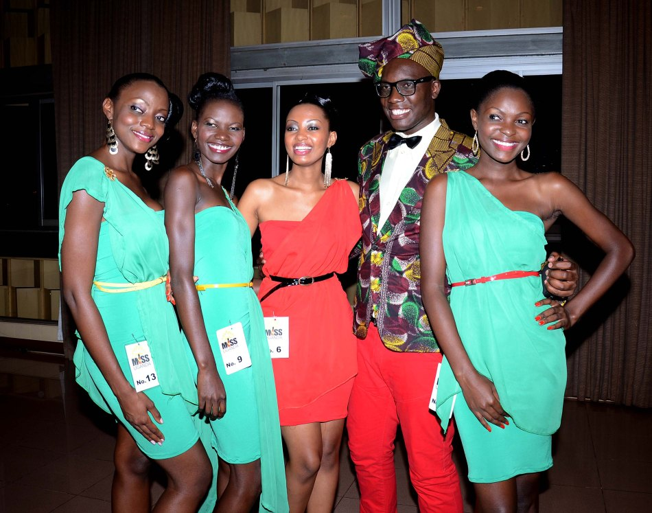 Joram Muzira (2nd right) the chief scout for Miss Uganda 2013 poses with some of the finalists at the presentation night.